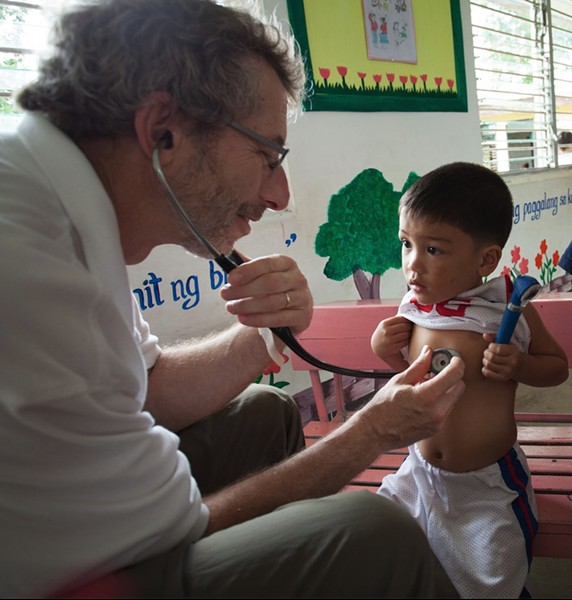 Dr. Barry Finette evaluating a young patient in the Philippines. - FILE PHOTO COURTESY OF DR. BARRY FINETTE