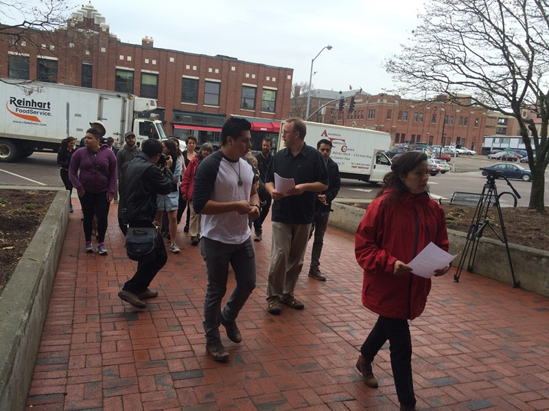 Members of Migrant Justice walk towards Sen. Patrick Leahy's Burlington office. - ALICIA FREESE