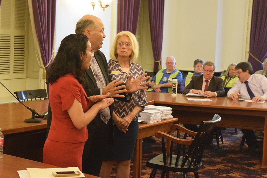 Reps. Kesha Ram (D-Burlington), Mike Hebert (R-Vernon) and Marianna Gamache (R-Swanton) speak about an energy siting bill Friday at the Statehouse. - TERRI HALLENBECK