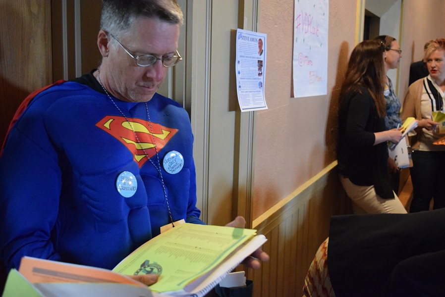 Randy Leavitt of Royalton dressed as Superman to protest superdelegates. - TERRI HALLENBECK
