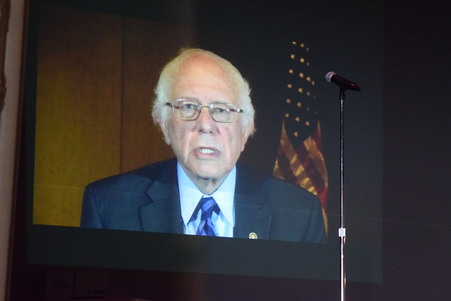 Sen. Bernie Sanders (I-Vt.) appears via video at Sunday's convention. - TERRI HALLENBECK