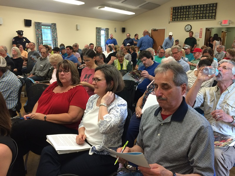 More than 100 people crowd a Rutland Board of Aldermen meeting. - MARK DAVIS
