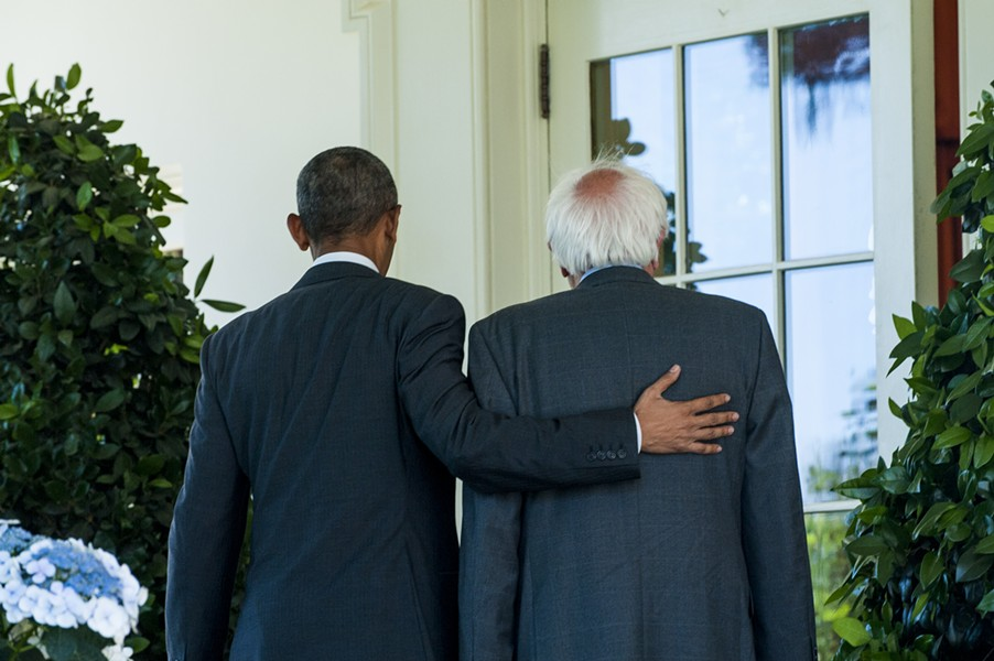 President Barack Obama and Sen. Bernie Sanders walk past the Rose Garden Thursday on their way to an Oval Office meeting. - PETE MAROVICHI/POOL/SIPA USA, VIA ASSOCIATED PRESS