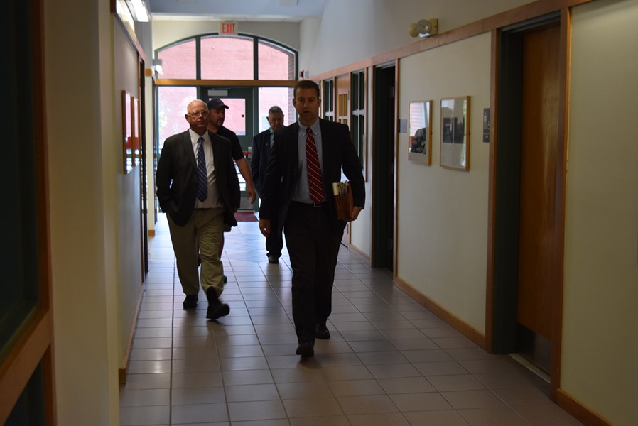 Sen. Norm McAllister (left) walks through the Franklin County court building in St. Albans with his attorney, Brooks McArthur, on Monday. - TERRI HALLENBECK