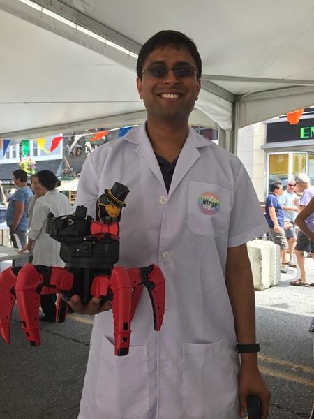 Nirav Shah, of Burlington's Laboratory B, with Fluffy the laser-shooting robot