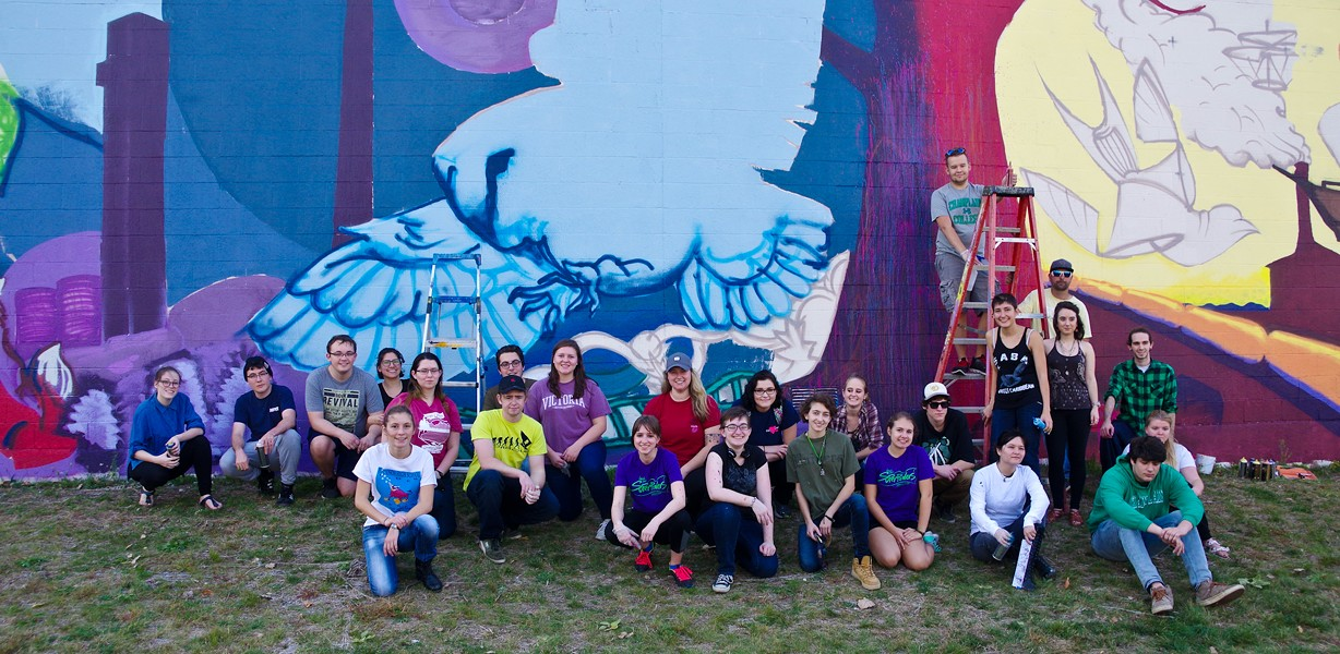 Champlain College students in front of their mural with Anthill Collective - STEPHEN MEASE