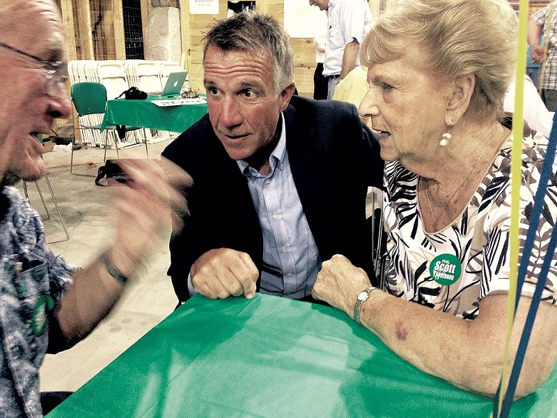 Phil Scott talking with Homer and Margaret Fitts of Barre - MOLLY WALSH