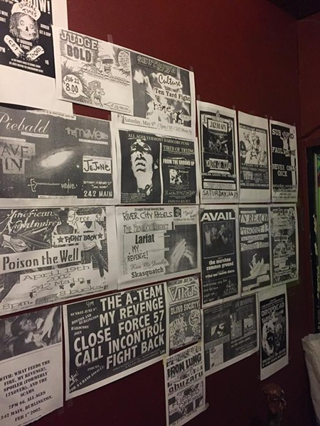 An archive of past flyers hang on the walls of 242 for its farewell show. - 242 MAIN