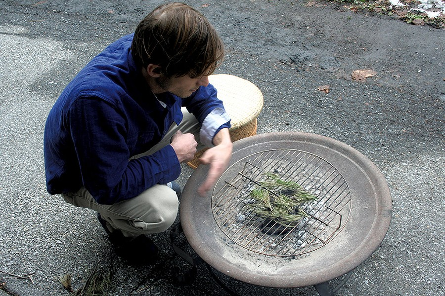 John Wetzel, owner of Stone Leaf Teahouse, preparing to make lapsang souchong - SUZANNE PODHAIZER