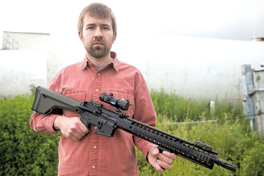 Paul Heintz with the AR-15 - FILE: JAMES BUCK