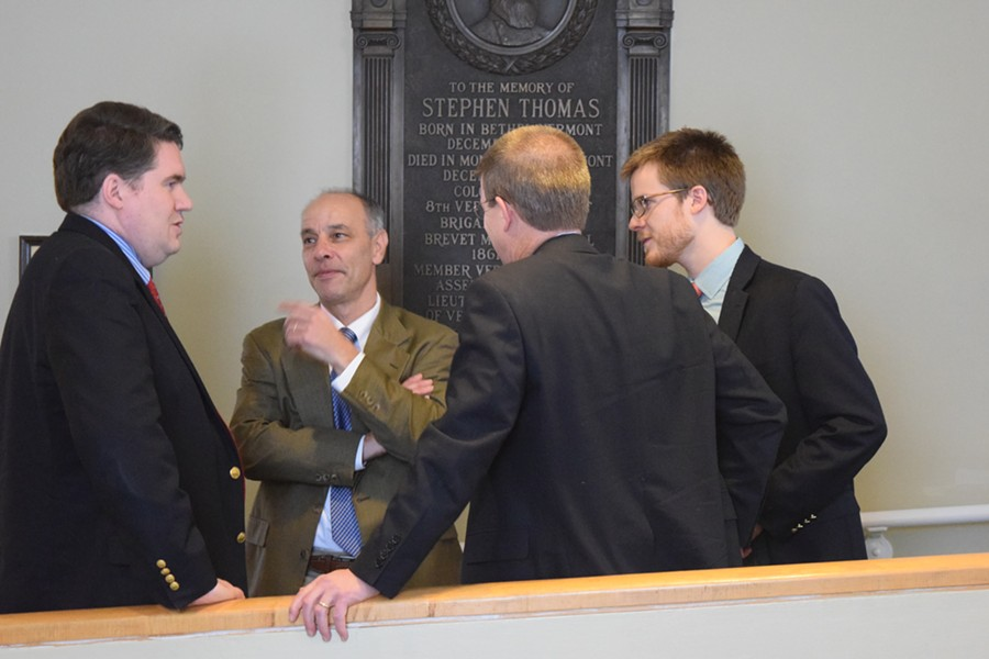 House Speaker Shap Smith, back to camera, confers with Reps. Oliver Olsen, left, and Adam Greshin, and Smith's aide, Dylan Giambatista. - TERRI HALLENBECK