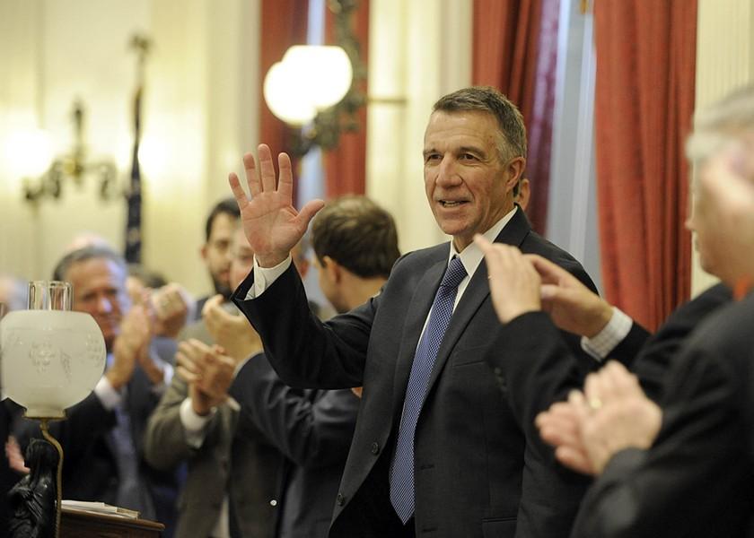 Scott waves as lawmakers applaud. - JEB WALLACE-BRODEUR