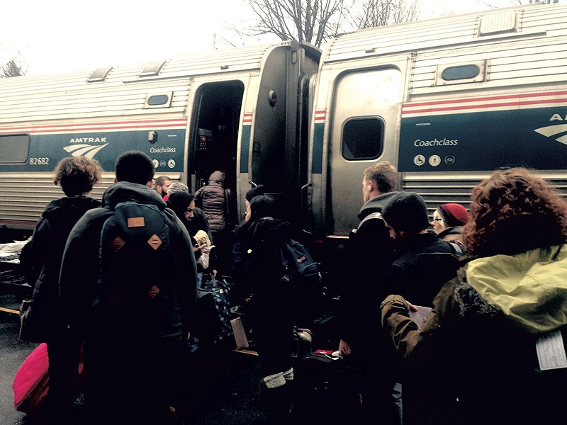 Passengers boarding the Amtrak Vermonter in Essex Junction - MOLLY WALSH