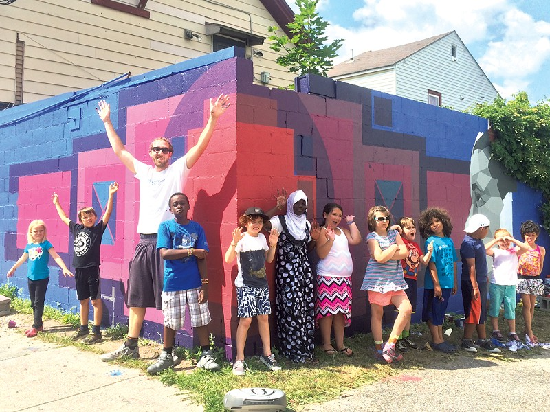 Sloan Collins and his helpers in front of a mural supported by the BCA Community Fund - COURTESY OF BURLINGTON CITY ARTS