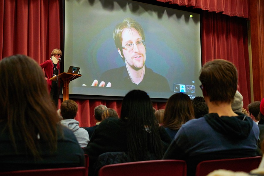 Edward Snowden chats with professor Allison Stanger. - TODD BALFOUR