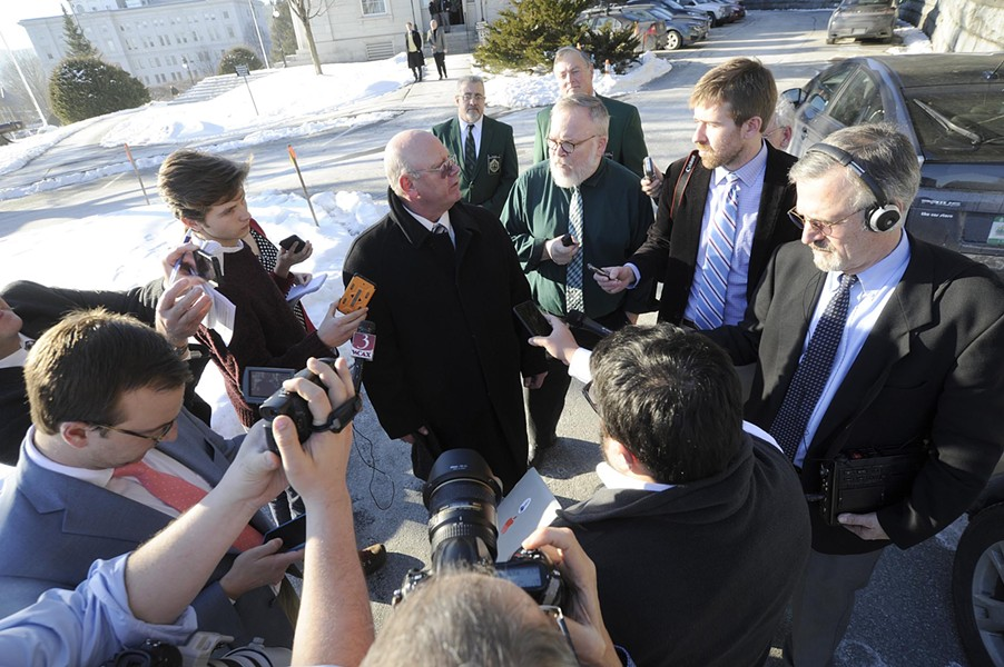 Then-senator Norm McAllister addresses reporters outside the Statehouse. - FILE