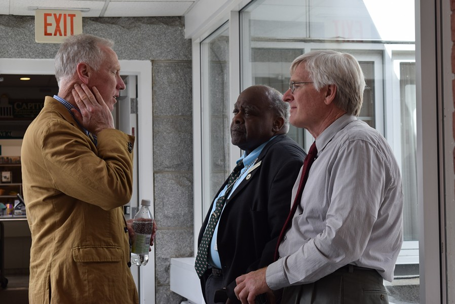 Jeff Fannon, executive director of the Vermont-National Education Association, left, speaks with Reps. Kevin Christie, middle, and John Bartholomew. - TERRI HALLENBECK