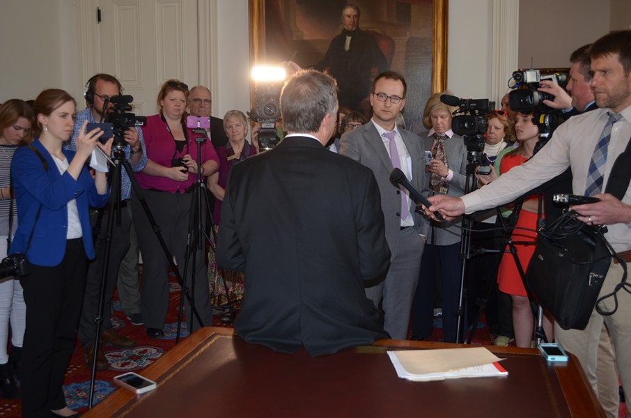Gov. Phil Scott addresses reporters in his ceremonial office last week. - ALICIA FREESE