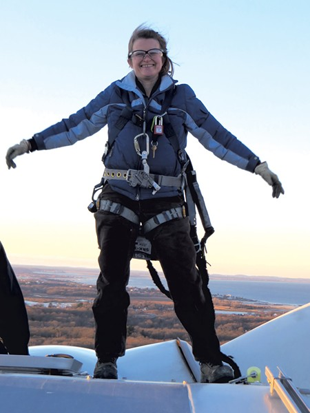 Sally Wright atop a wind turbine - COURTESY OF SALLY WRIGHT