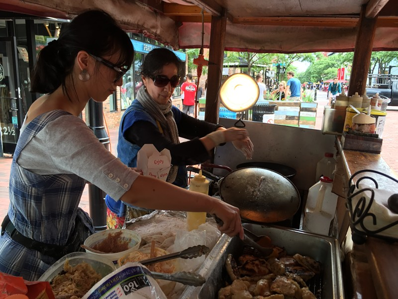 Lisa Li and Hong Yu cook dumplings on Church Street - SALLY POLLAK