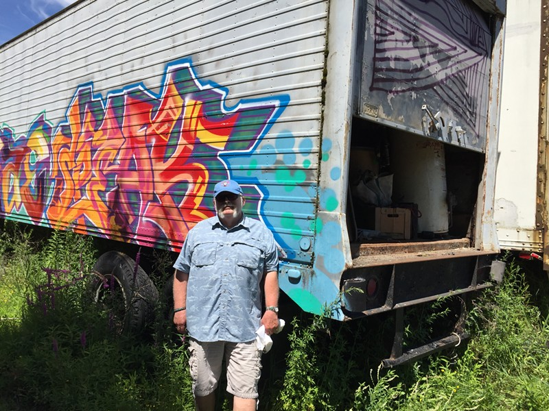Rick Norcross at his tractor-trailer of Chew Chew Festival gear - SALLY POLLAK