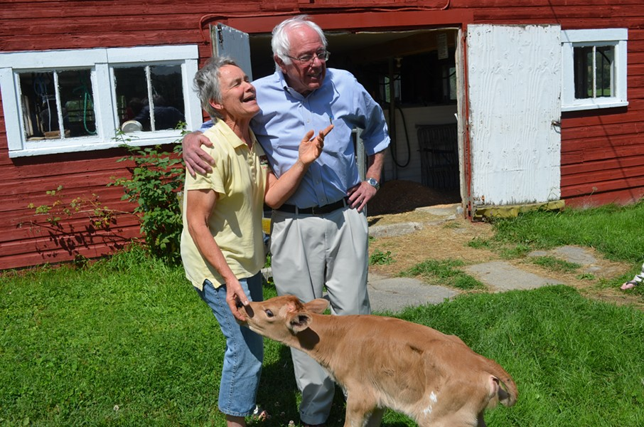 Sanders stands with Linda Stanley and her newborn calf. - ALICIA FREESE
