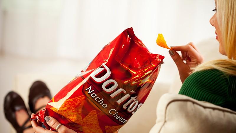Woman with Doritos.