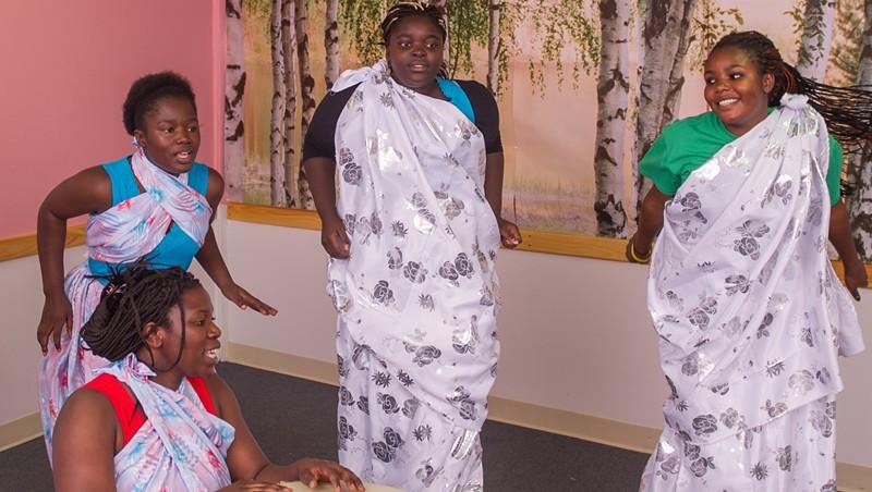 Aline Mukiza (with drum) and Burundian dancers