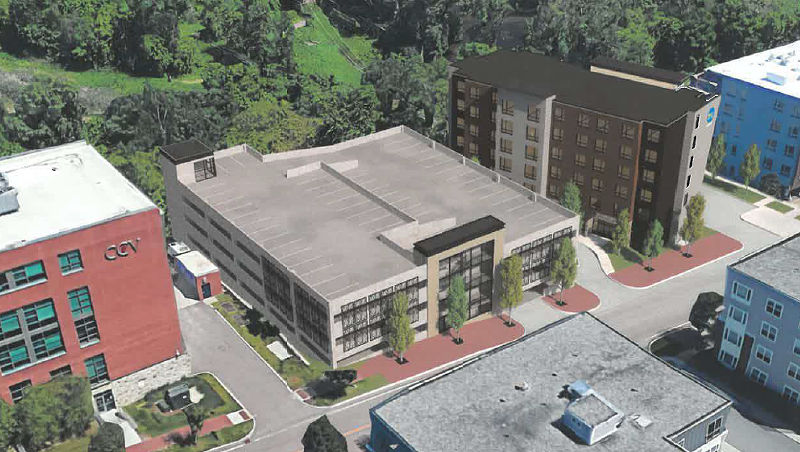 A rendering showing the proposed parking garage and hotel next to the existing Community College of Vermont building