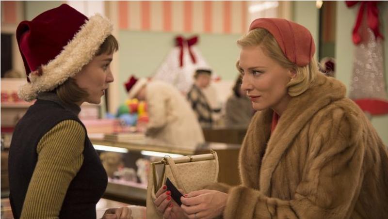 Cate Blanchett looks like she has a Christmas present for Rooney Mara in Carol.