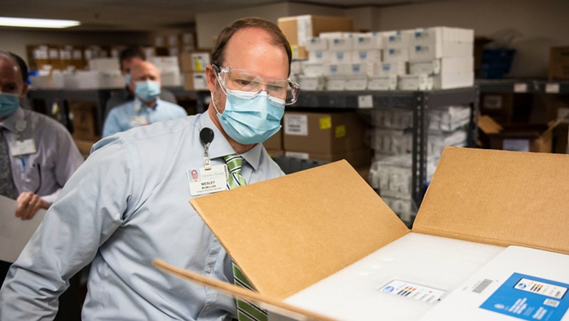 Wesley McMillian, director of pharmacy at UVM Medical Center, with a shipment of vaccine