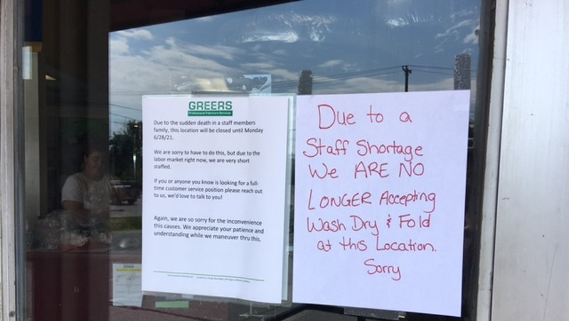 A sign on the front door of a Burlington business
