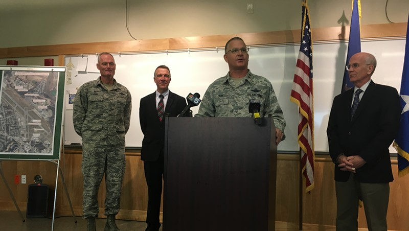 Major General Steven Cray announces a deployment to the Middle East. Behind him, from left, are Col. Patrick Guinee, governor-elect Phil Scott and U.S. Rep. Peter Welch (D-Vt.).