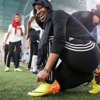 The Golden Blazers Girls Soccer Team Fama Haji lacing up her boots James Buck