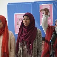 International Women's Day Celebration in Burlington Left to right: Muslims Girls Making Change slam poets Lena Ginawi, Kiran Waqar and Balkisa Abdikadir Matthew Thorsen