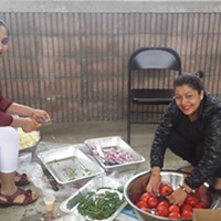 Sansari Puja and Buddha Jayanti Festivities In Burlington In May 2017 Krishna (left) and Durga Adhikari helping to prepare food Kymelya Sari