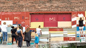 King Street Center and community volunteers painting the Moran Plant with Clark Derbes in 2015