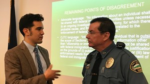 Jay Diaz, a staff attorney for the Vermont chapter of the American Civil Liberties Union, speaks with Brandon Police Chief Christopher Brickell.