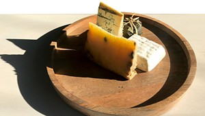 Piedmont and Lombardy cheese board at Dedalus Wine Shop: Robiola Tre Latti Fico (in leaf), Bergamino di Bufala (white square), Castelmagno d'Alpeggio (golden), Blu Imperiale (blue)