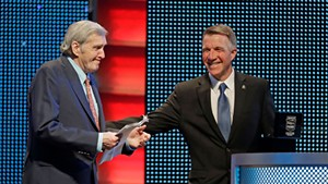 Gov. Phil Scott (right) inducts Ken Squier into NASCAR's Hall of Fame in Charlotte, N.C.