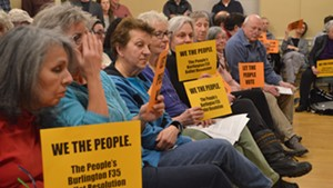 Opponents of the F-35s at the City Council meeting
