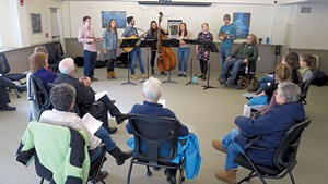 The University of Vermont Folk Music Club performing at Queen City Memory Café