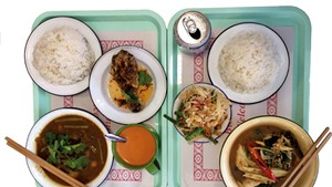 Fried chicken, papaya salad, jungle curry, cha Thai, and hunglay curry at Pumpui Grocer and Curry Shop