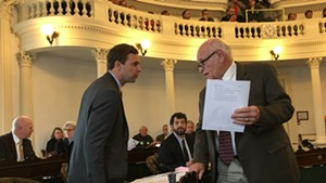 Senate President Pro Tempore Tim Ashe consulting with Sen. Dick Sears during a recess in the S.55 debate