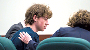Jack Sawyer with defense attorney Kelly Green in court