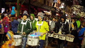 Drum Corps parading on Church Street during First Night Burlington