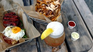 Parmesan truffle fries, Worthy Burger with egg and blue cheese, and the John Daly cocktail