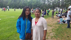 Interpreter Poe Poh (left) and Thaw Theet at Leddy Park in Burlington