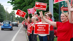 An ambulance, a firetruck and a police car were among the automobiles that honked support for the nurses Thursday.