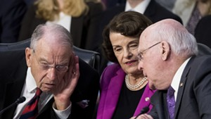 Sen. Chuck Grassley (R-Iowa) and Sen. Dianne Feinstein (D-Calif.) listen as Sen. Patrick Leahy (D-Vt.) speaks during the confirmation hearing of Brett Kavanaugh.